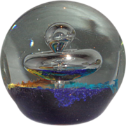 Art Glass Large Paperweight With Controlled Bubble Coming From A Swirling Crystal Mushroom Over A Multicolor Ground