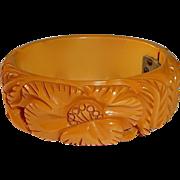 Butterscotch Bakelite Heavily Carved Poppy Clamper Bracelet