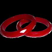 Red Bakelite Pair of Faceted Bangle Bracelets