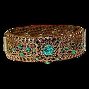 Czechoslovakia Gold Tone Metal Emerald Green Rhinestone Filigree Hinged Bangle Bracelet