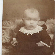 Real Photo of Wide Eyed Baby in Velvet and Lace