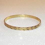 Vintage Gold Tone Hard Bangle Diamond Cut
