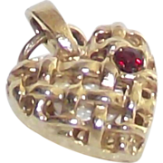Open Lattice Work Heart Charm with Tiny Red Stone