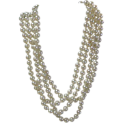 "Simulated Pearls.  Flapper length 72"".  Individually knotted.  Heavy.  Absolutely Gorgeous."