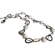 Voyage: White Freshwater Cultured Pearls with a Twist of Chains
