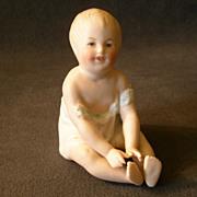 "Gebruder Heubach  3"" Seated ""Boy"" Piano Baby Figurine"