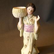 "Gebruder Heubach ""Oriental Lady Carrying a Woven Basket"" Figurine"