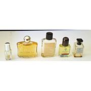 4 Different Miniature Perfume Bottles + 1 Mini Bath Oil