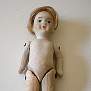 Antique Metal Pin Jointed Bisque Doll With Hair