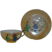Painted Porcelain lustre geisha cup and saucer