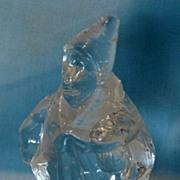 Clear glass figurine of clown