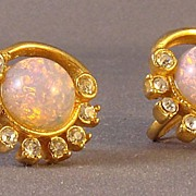 Yellow metal screw back earrings with rhinestones and opalescent stones