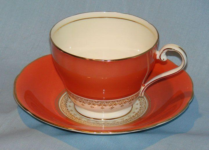 Aynsley bone china cream, coral and gold cup and saucer 1920's mark