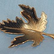 Burnished gold tone leaf pin