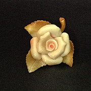 Moulded celluloid yellow rose pin
