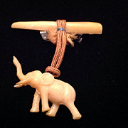 Vintage celluloid elephant and tusk pin