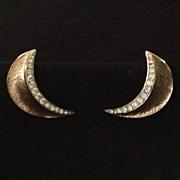 Trifari burnished gold tone crescent earrings with rhinestones