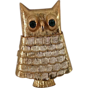 Avon Somewhere solid perfume Owl pin with green rhinestone eyes.