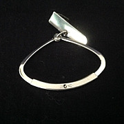 Unusual adjustable silvertone tie ring with small rhinestone