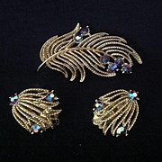 Lisner pin and earring set with iridescent rhinestones