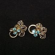 Turquoise blue rhinestone and gold tone filigree flower screw back earrings