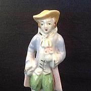 Colonial gentleman glazed bisque figurine with bouquet Japan