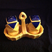 Bright Yellow and Blue Salt and Pepper Shakers in a Carrier