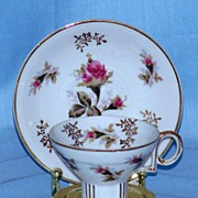 Decorative Cup and Saucer Set with Pink Roses
