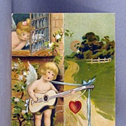 SALE 1909 Valentine Cupid serenading with a guitar  Saxony