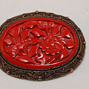 European Carved Cinnabar and Sterling Silver Brooch