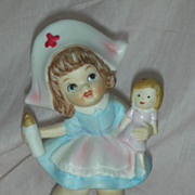 Wonderful and Rare Vintage Nurse Bisque Figurine Holding a Doll