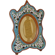 Antique Micromosaic mirror with daisies and green leaves on a turquoise ground