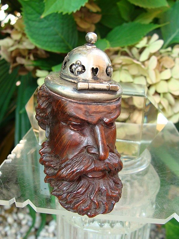 Hand carved wooden pipe with silver lid