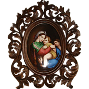 SOLD Handpainted porcelain miniature depicting Our Lady of the table set in a fine carved Flor