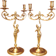 Pair of candelabra, gilded metal, dated at about 1900