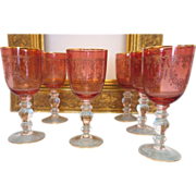 SOLD A beautiful set of six antique Moser cranberry wine glasses with gilded engraving