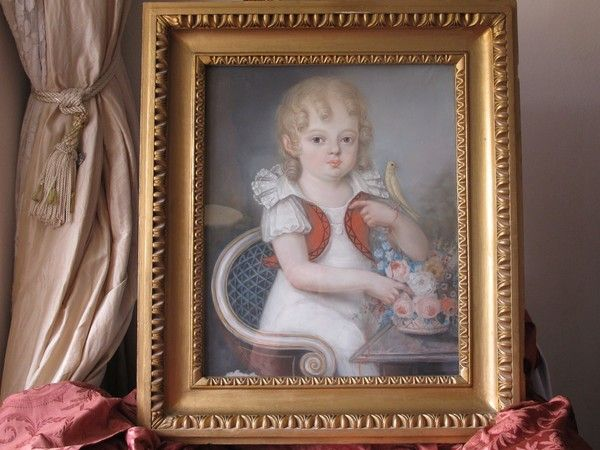 Antique Biedermeier chalk drawing depicting a little girl with a canary,dated at about 1830