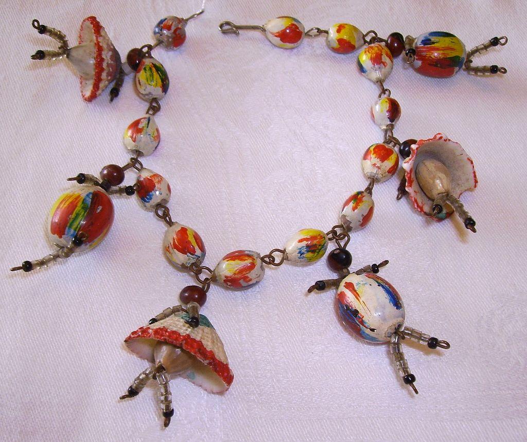 Unusual Folk Art Shell, Seed, & Bead People Charm Bracelet
