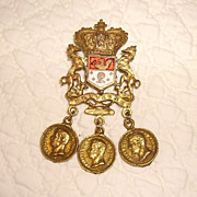Early Regal Coro Heraldic Shield Pin with Replica Coins.