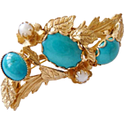 Unsigned faux turquoise and faux moonstone gold tone brooch pin