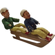 SOLD Pair of German Spun Cotton/Compo Boys on Sled
