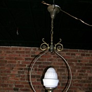Brass hanging light with it's original pressed milk glass globe