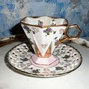 Opalescent Royal Sealy   Violets Footed Cup and Saucer