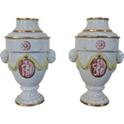 Pair 18th c. Neoclassical German Hochst Porcelain Urns / Vases with Cherub Mask Handles