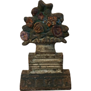Antique 19th century American Cast Iron Door Stop in the Form of a Classical Urn with Flowers