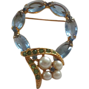 Stylized Hot Air Balloon Shaped Gold-toned Broach with Blue Open-backed Rhinestones and Faux .