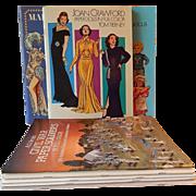 Eight Uncut Paper Doll Books