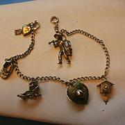 SALE PENDING Vintage Sterling Charm Bracelet 6 Sterling Charms