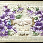 Early 1900s Deeply Embossed, Plastic-Coated, Gilded Postcard,  Man and Woman Clasp Hands, Violets