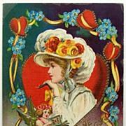 "Early 1900s Embossed Gilded Gel Postcard, Cupid Sings ""Songs of Love"" to Lovely Vict"